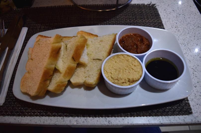 Warm Focaccia, Tomato Tapenade, Houmous, Oil & Balsamic